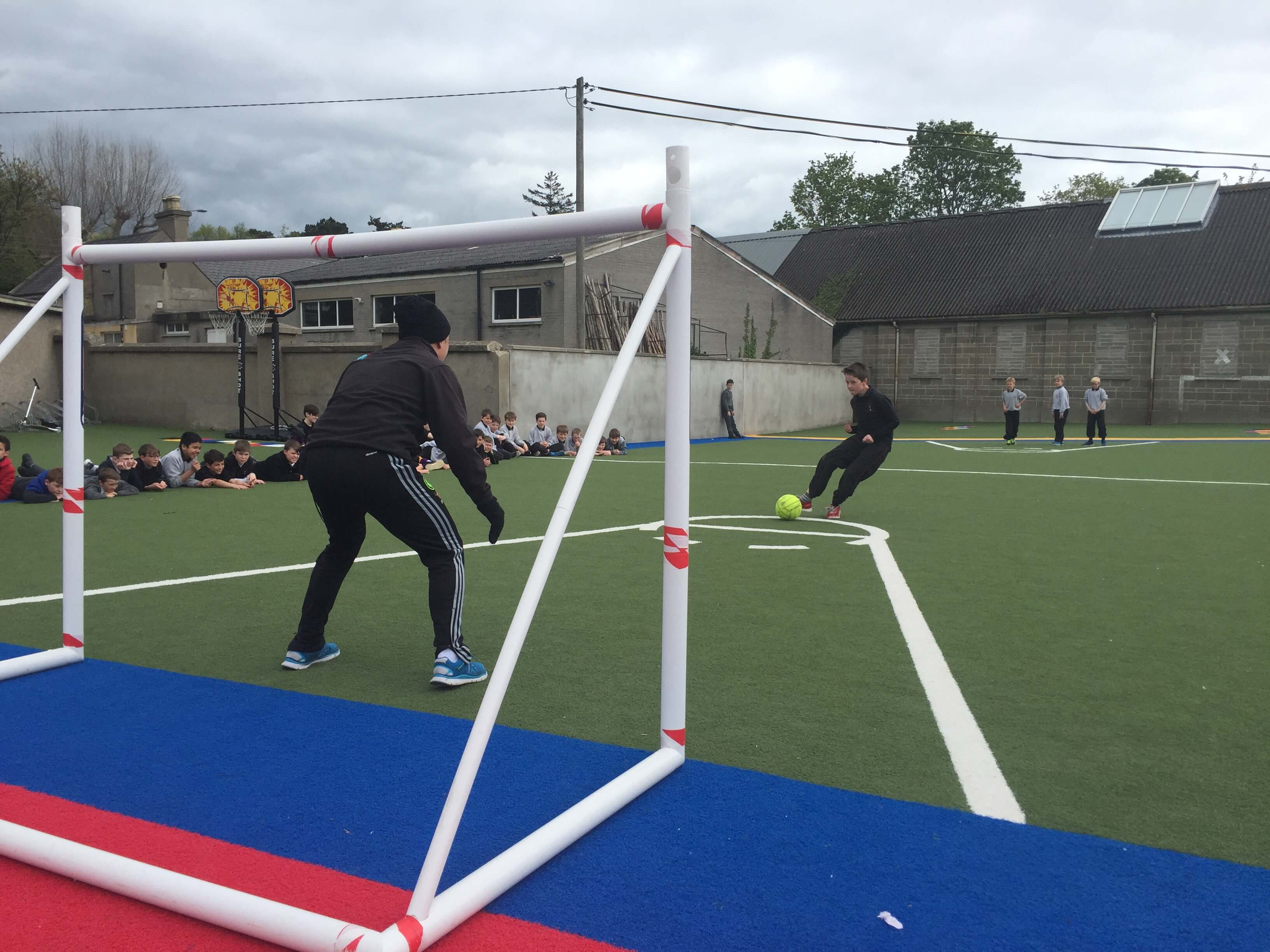 A photo of a St Laurences BNS teacher as a goalkeepers during a football game on Active Day