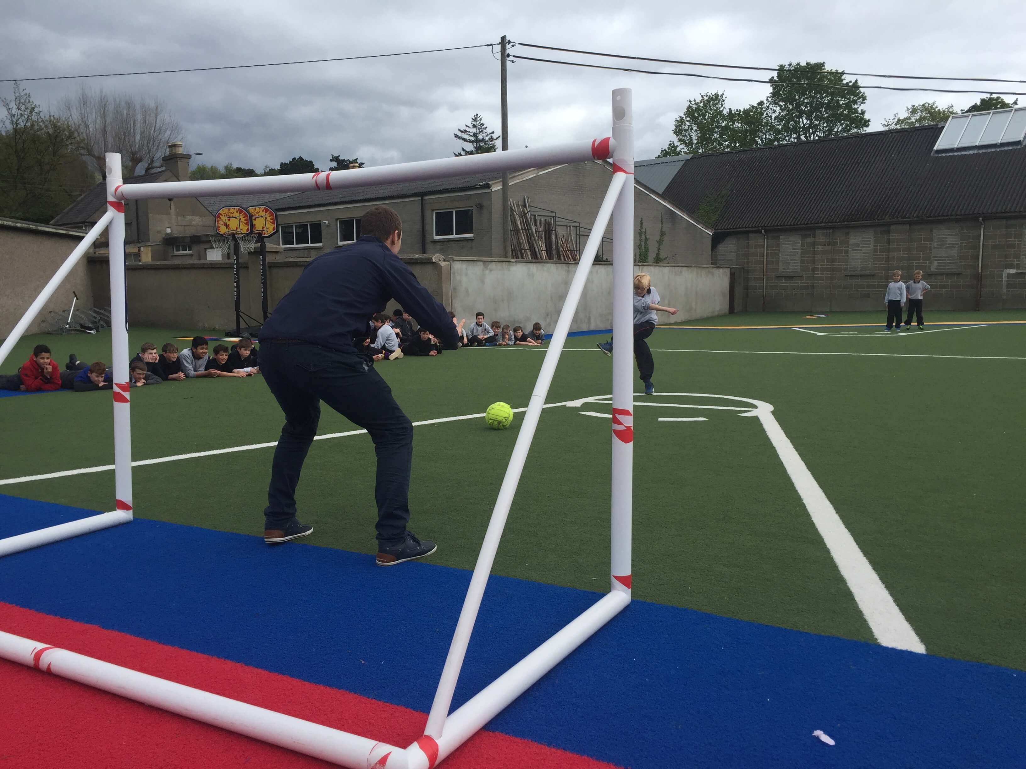 A photo of a St Laurences BNS teacher as a goalkeepers during a football game on Active Day_1