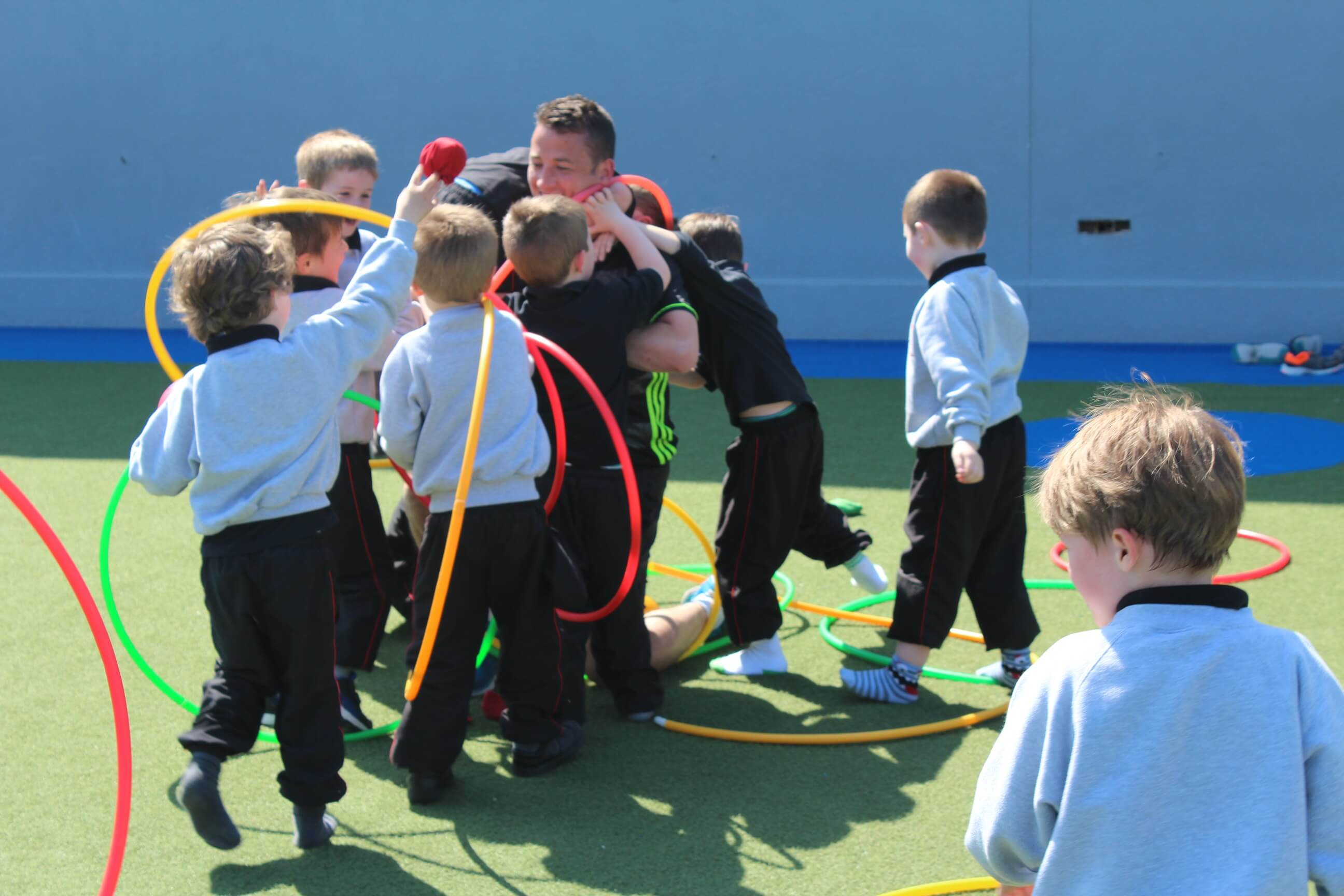 A photo of a St Laurences BNS teacher with his students playing on Active Day